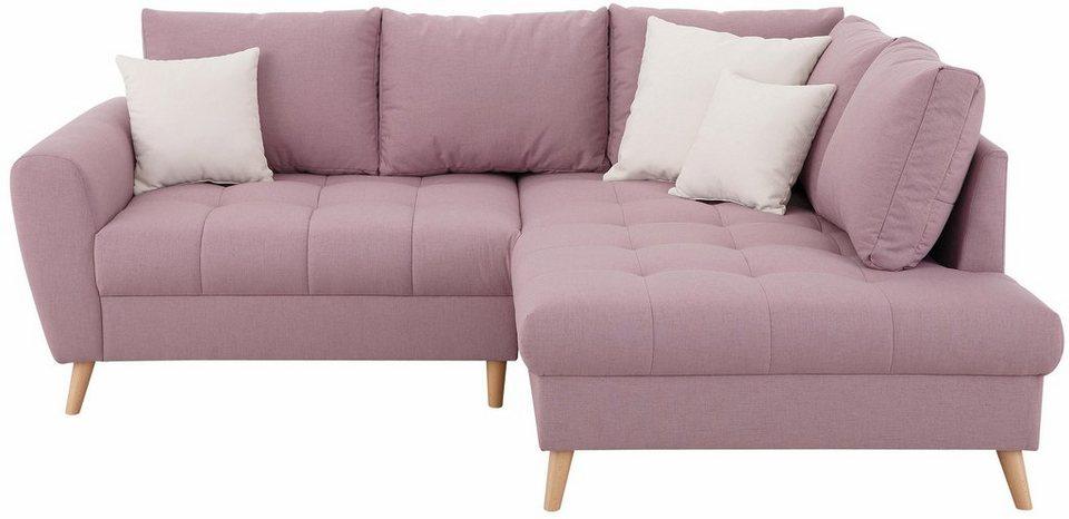 Roze hoekbank met kussens